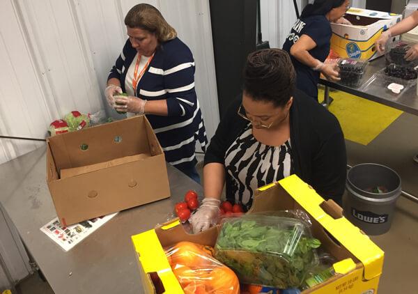 Oxford companies volunteer at food gatherer's Ann Arbor